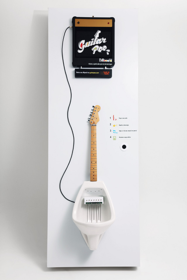guitar urinal that makes music while you pee