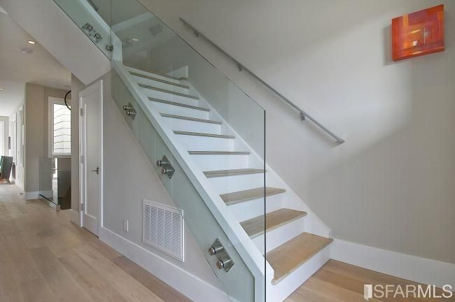 picture of the hallway remodeled with glass walled stairs