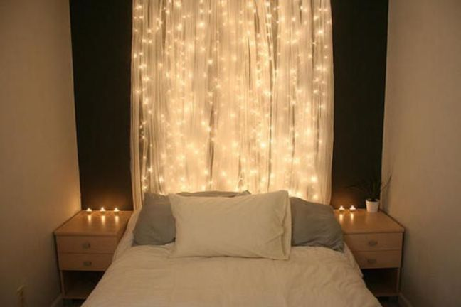 White lights behind a sheer white curtain to give a golden glow.